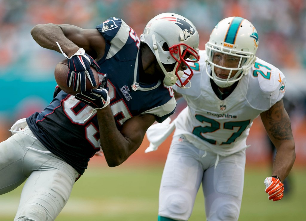 New England Patriots wide receiver Kenbrell Thompkins (85) is defended by Miami Dolphins defensive back Jimmy Wilson (27) at Sun Life Stadium in Miami Gardens, Florida on September 7, 2014. (Allen Eyestone / The Palm Beach Post)