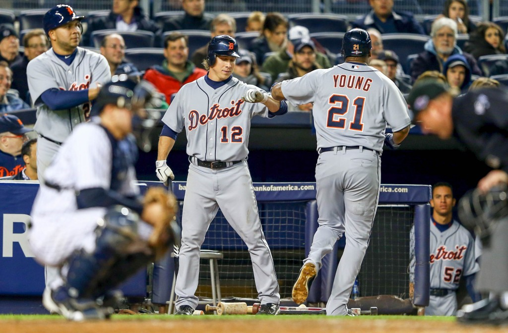 NEW YORK, NY - OCTOBER 13:  Delmon Young #21 of the Detroit Tigers is congratulated by teammate Andy Dirks #12 after Young scored on his solo home run in the top of the eighth inning against the New York Yankees during Game One of the American League Championship Series at Yankee Stadium on October 13, 2012 in the Bronx borough of New York City, New York.  (Photo by Al Bello/Getty Images)
