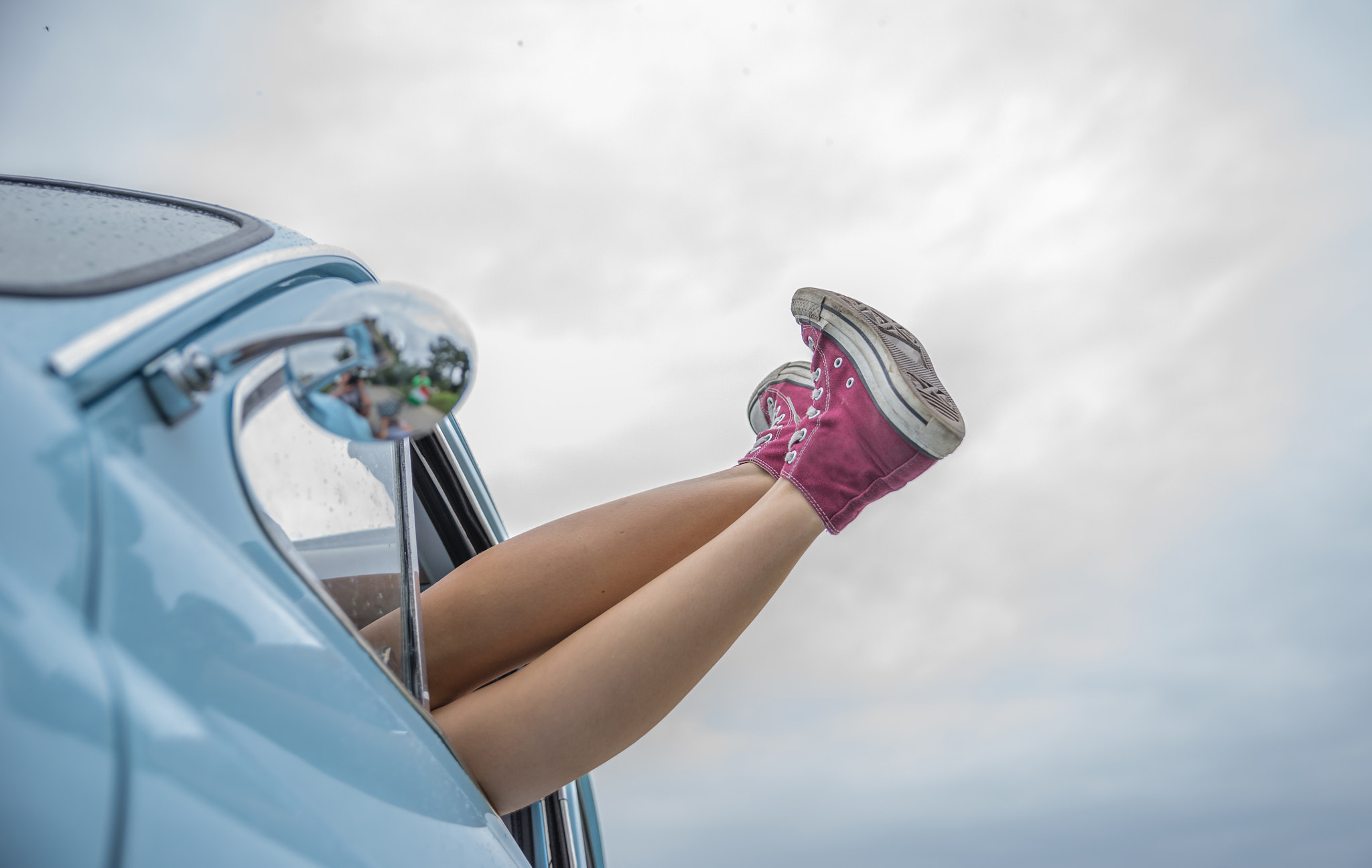 Freedom girl with sneaker out of car