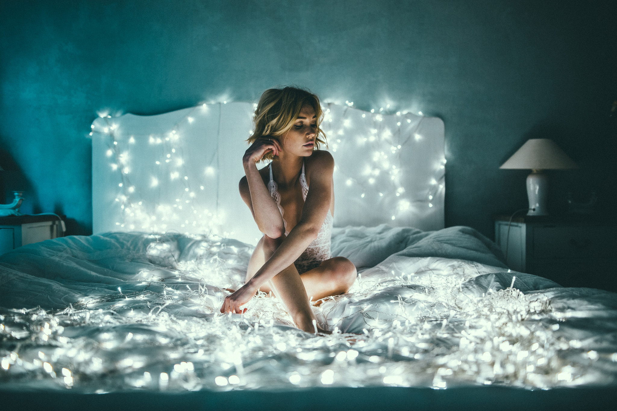 beautiful girl on bed with led lights