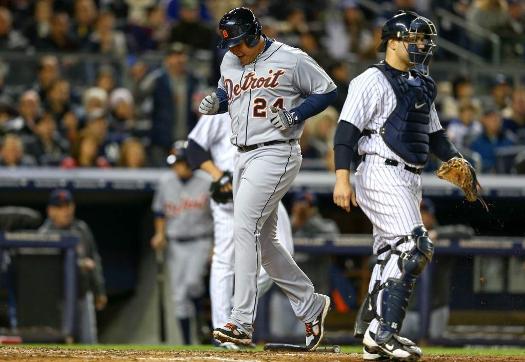 NEW YORK, NY - OCTOBER 13:  Miguel Cabrera #24 of the Detroit Tigers scores on a RBI single hit by Delmon Young #21 in the top of the sixth inning against the New York Yankees during Game One of the American League Championship Series at Yankee Stadium on October 13, 2012 in the Bronx borough of New York City, New York.  (Photo by Al Bello/Getty Images)