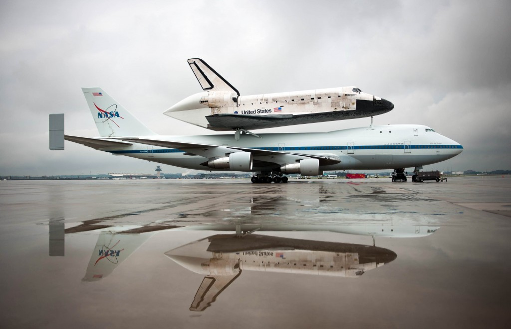 Space shuttle Discovery, mounted atop a NASA 747 Shuttle Carrier Aircraft (SCA) is seen a few hours before being demated at Washington Dulles International Airport, Wednesday, April 18, 2012, in Sterling, VA.  Discovery, the first orbiter retired from NASA's shuttle fleet, completed 39 missions, spent 365 days in space, orbited the Earth 5,830 times, and traveled 148,221,675 miles. NASA will transfer Discovery to the National Air and Space Museum to begin its new mission to commemorate past achievements in space and to educate and inspire future generations of explorers. Photo Credit: (NASA/Bill Ingalls)