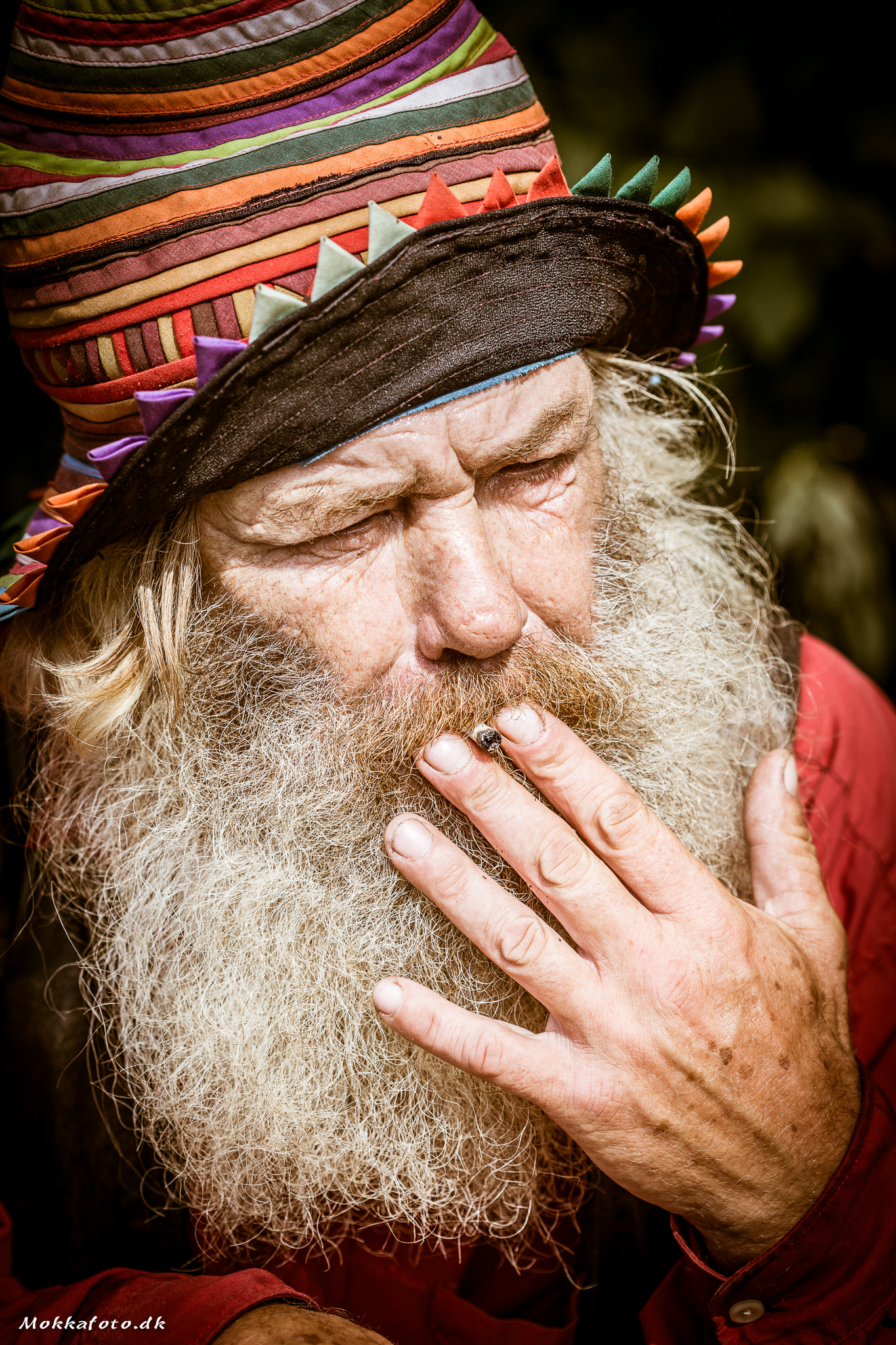 old man smoking last puff weed joint