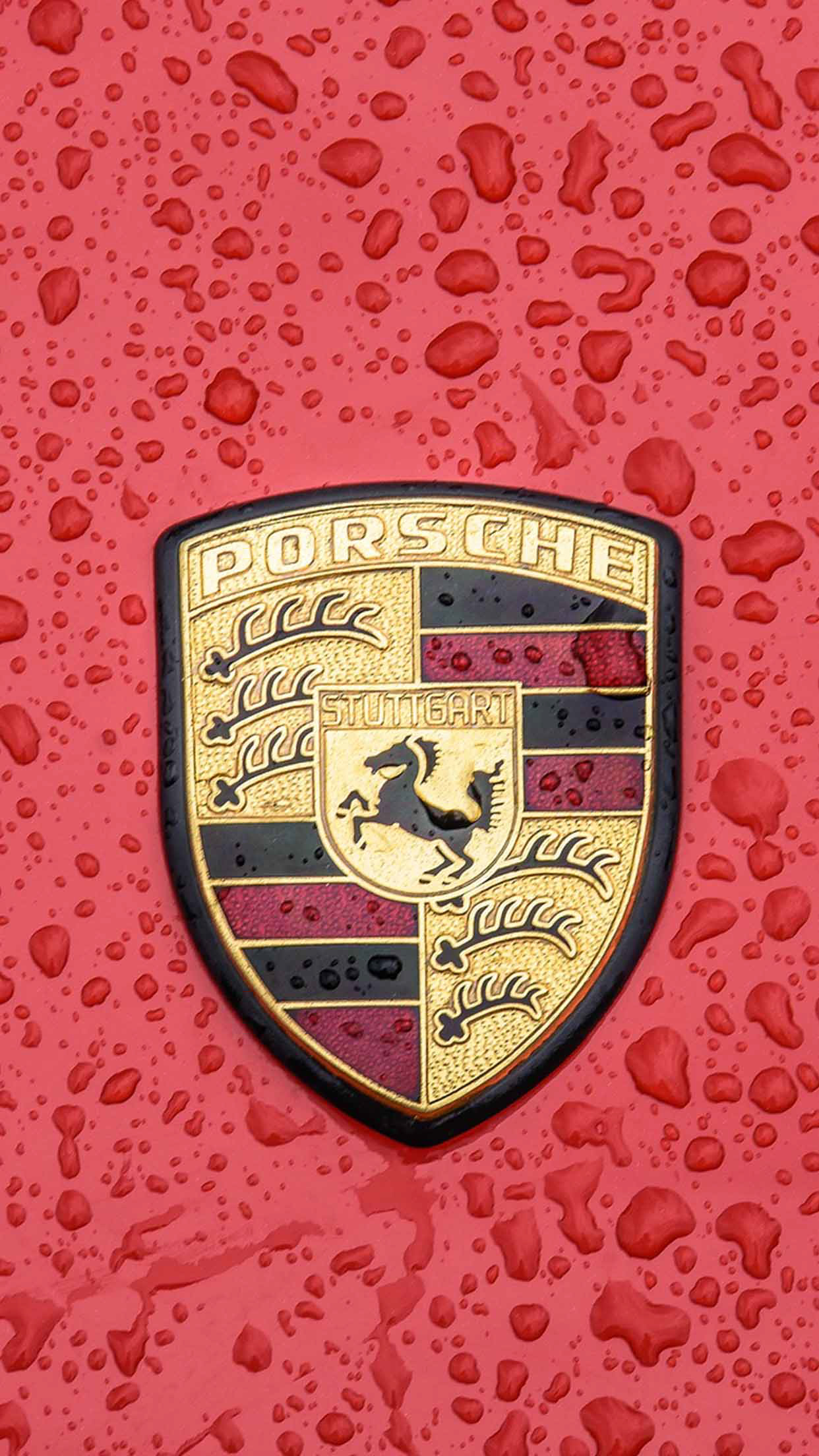 Porsche red logo with rain
