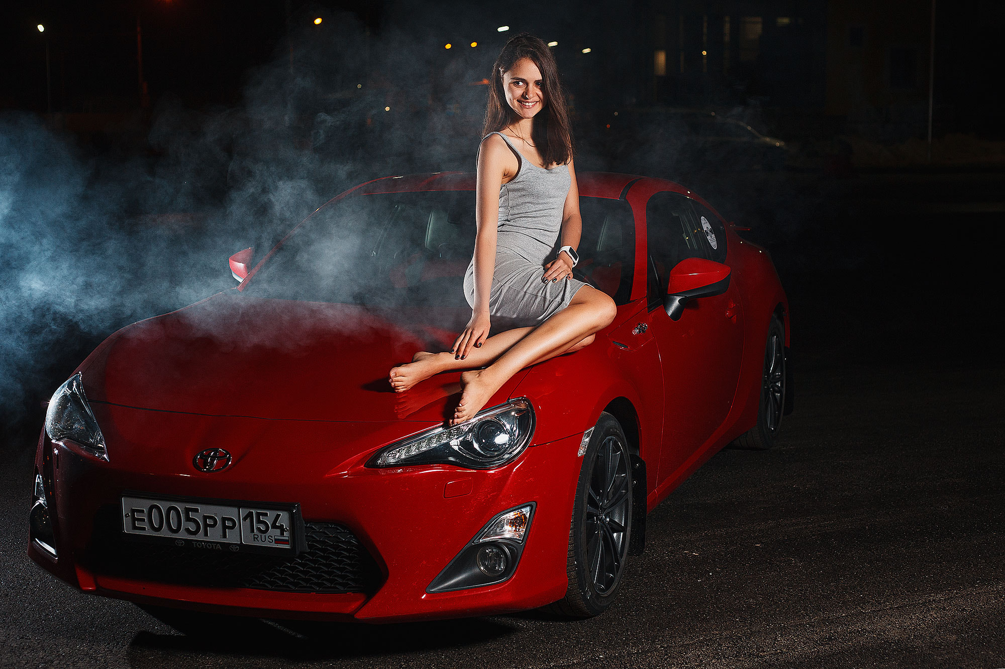 Posing girl on car bonet